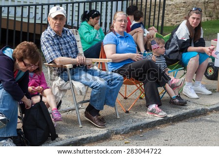"Shelton, CT, USA - May 25, 2015: Spectators enjoying the ""Veterans Day Parade"" in Shelton, Connecticut, on May 25, 2015"