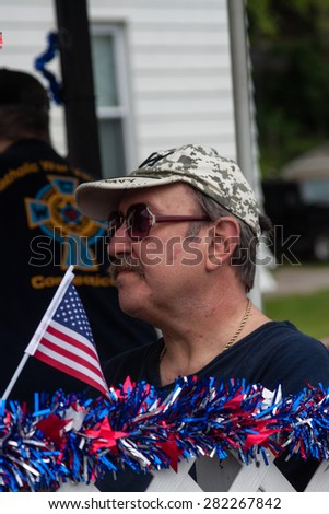 "Shelton, CT, USA - May 25, 2015: The individuals are some of the many participants at the ""Memorial Day Parade"" held in Shelton, Connecticut, on May 25, 2015."