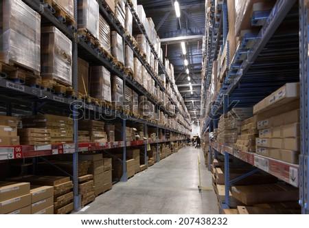 Shelves and racks in distribution storehouse interior - stock photo