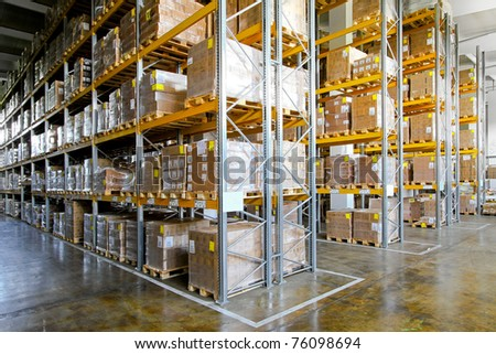 Shelves and racks in distribution storehouse interior - stock photo