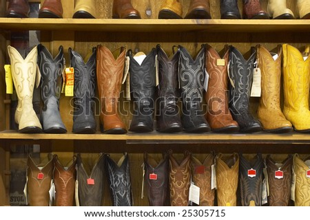 Shelves full of new cowboy boots. - stock photo