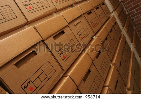 Shelves lined with boxes of company records in a secure records room environment. - stock photo