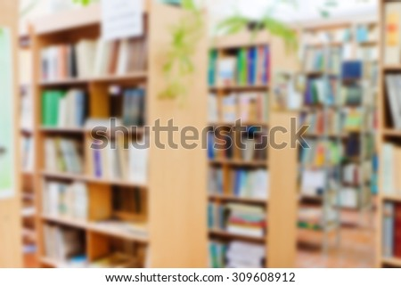 shelves of books in the library, background - stock photo