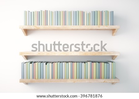 Shelves with books on painted white wall background - stock photo