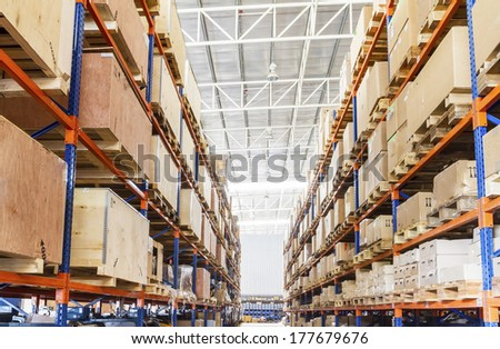 Shelves with boxes in factory warehouse - stock photo