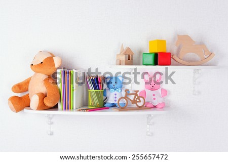 shelves with toys in child room closeup