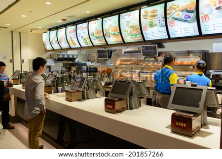 SHENZHEN - APRIL 16: KFC restaurant on April 16, 2014 in Shenzhen, China. KFC is a fast food restaurant chain that specializes in fried chicken and is headquartered in Louisville, Kentucky - stock photo