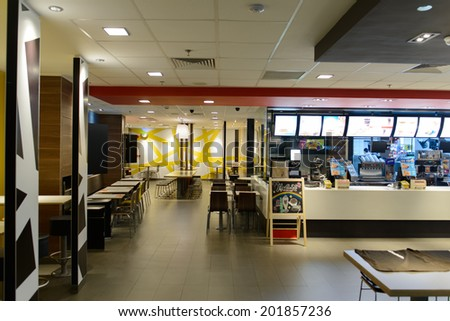 SHENZHEN - APRIL 16: McDonald's restaurant on April 16, 2014 in Shenzhen, China. The McDonald's Corporation is the world's largest chain of hamburger fast food restaurants - stock photo