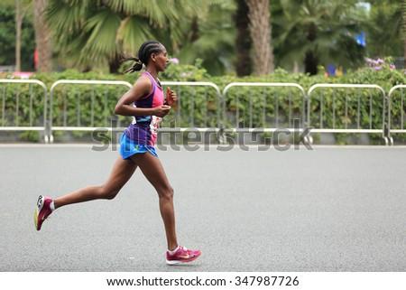 SHENZHEN, CHINA - DECEMBER 5: Marathon runner on the street at the third Shenzhen International Marathon DECEMBER 5, 2015 in Shenzhen China - stock photo