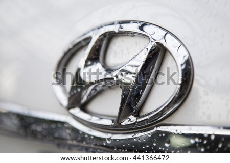 Shenzhen, China - Jun 14, 2016: Close up of the logo of Hyundai motor on the car front, taken in a test drive. Hyundai  is a South Korean automotive manufacturer, headquarter in Seoul, South Korea.