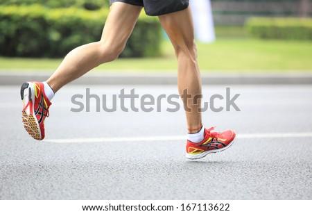 SHENZHEN - DEC 08: Unidentified athlete running at the shenzhen international marathon 2013, shennan road,shenzhen city,China,on DEC 08,2013 at Shenzhen city,Guangdong province,China.  - stock photo
