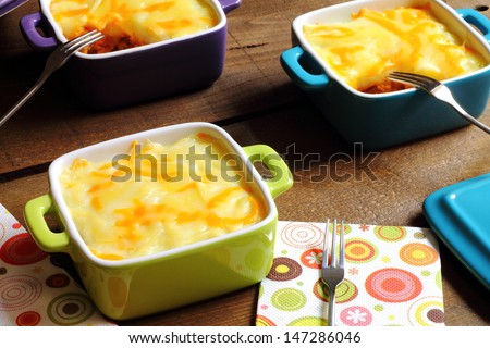 Shepherd's pie in individual casseroles - stock photo