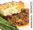 Shepherd's pie with asparagus - stock photo