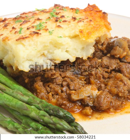 Shepherd's pie with asparagus - stock photo