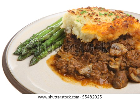 Shepherds pie with asparagus. - stock photo