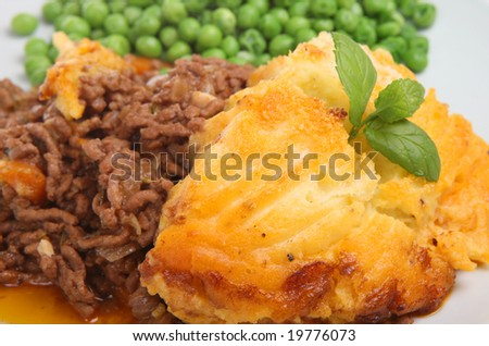 Shepherds pie with peas. - stock photo
