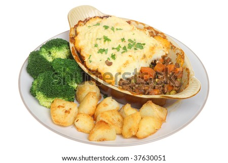 Shepherds pie with sauteed potatoes and broccoli - stock photo