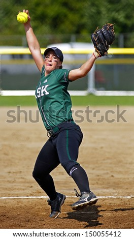 SHERBROOKE, CANADA - August 7: Saskatchewan pitcher Haley Volk in women's softball at the Canada Games August 7, 2013 in Sherbrooke, Canada. - stock photo