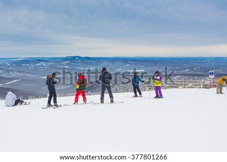 Sheregesh, Mountain Shoria, Kemerovo Region, Russia - February 08, 2016 :: Snowboarders and mountain ski riders on the top of the mountain.