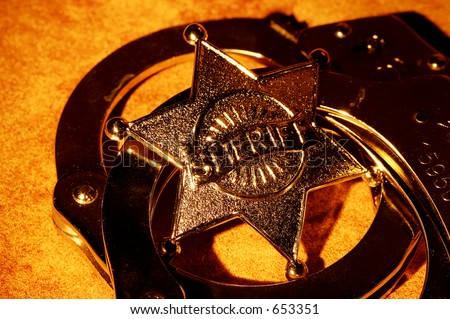 Sheriffs Badge and Handcuffs - stock photo