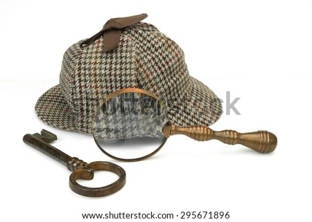 Sherlock Holmes Deerstalker Cap, Vintage Magnifying Glass And Old Key Isolated On White Background. Investigation Concept