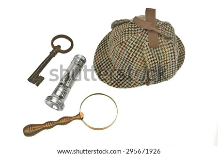 Sherlock Holmes Deerstalker Cap, Vintage Magnifying Glass, Retro Flashlight And Old Rusty Key Isolated On White Background. Investigation Concept