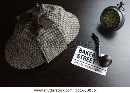 Sherlock Holmes Deerstalker Hat, Vintage Clock, Sign Baker Street And Smoking Pipe On The Black Table Background. Overhead View.  Investigation Concept. - stock photo
