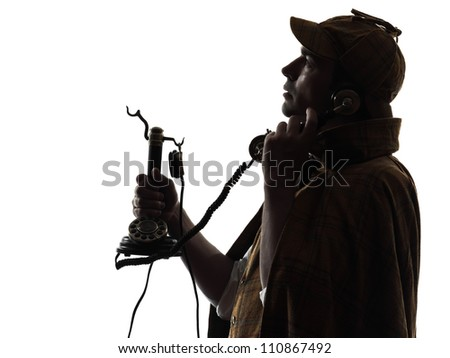 sherlock holmes silhouette on the phone in studio on white background - stock photo
