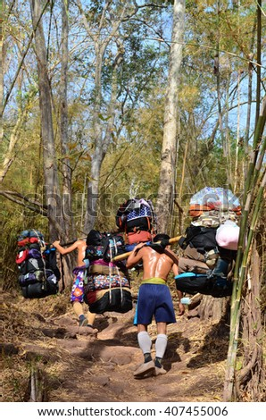 Sherpa Porter carrying heavy loads to Phu Kradueng National Park, Loei Province in Thailand