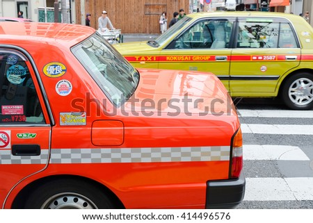 SHIBUYA, JAPAN - APRIL1, 2016 :Taxi cars on the street in the shibuya district in Tokyo, Japan - stock photo