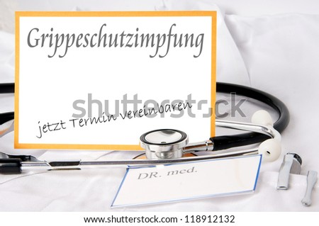 Shield with the german word Flu shot / Flu shot - stock photo