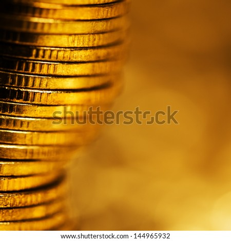 Shine of gold. Square composition, shallow DOF. - stock photo