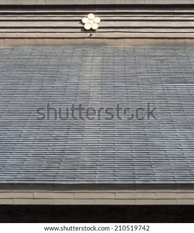 Shingled roof background pattern with gold star detail - stock photo