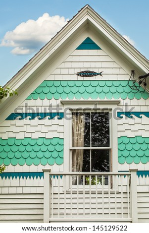 Shingles with a nautical motif on the exterior of a seaside cottage