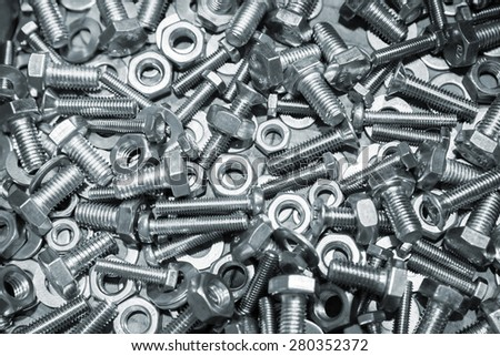 Shining bolts and nuts, blue toned photo background with selective focus  - stock photo