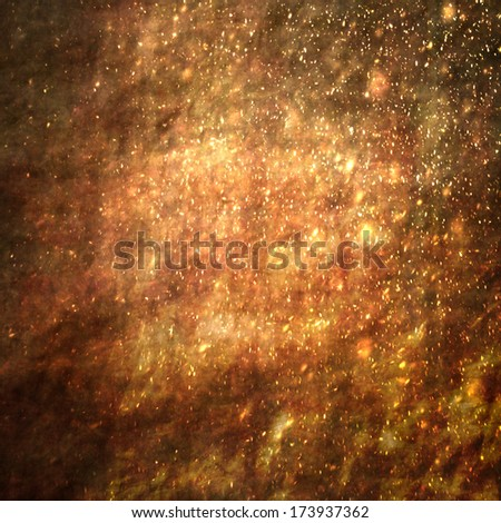 Shining golden sparkles on abstract grunge parchment texture, artistic background