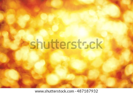 Shining out-of-focus highlights in gold and yellow, a bright bokeh background ideal for autumn or Christmas
