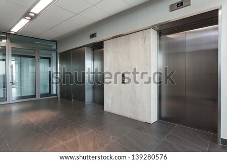 Shining silver elevator in a modern office building - stock photo