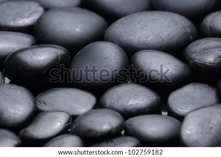 Shining smooth tropical beach stones - stock photo