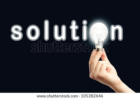 Shining solution word with bulb - stock photo
