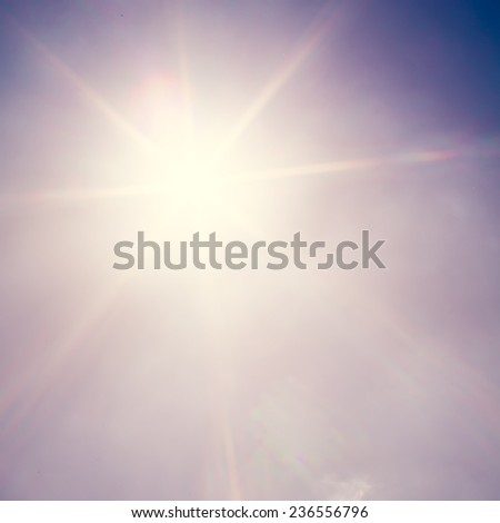 Shining sun at clear blue sky. Retro filter. - stock photo