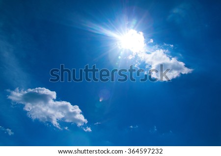 Shining sun at clear blue sky with copy space - stock photo