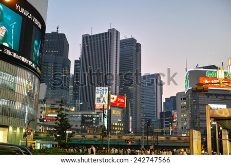 SHINJUKU, TOKYO - MAY 31, 2014: Illuminated commercial buildings, neon lights, billboards & restaurants in Shinjuku at night. One of the biggest & busiest commercial district in Japan. - stock photo