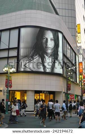 SHINJUKU, TOKYO - MAY 31, 2014: International fast fashion shop ZARA from Spain has big business in Japan. This is one of their branches situated in the center of Shinjuku area, metropolitan Tokyo. - stock photo