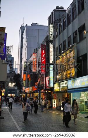 SHINJUKU, TOKYO - MAY 31, 2014: Shinjuku commercial district illuminated at night. Shinjuku is one of the biggest & busiest night life area in Japan. - stock photo