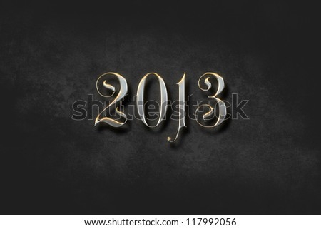 Shiny and metallic new year 2013 text digitally generated on a dark and textured background, with a soft vignetting effect to focus attention on the text. - stock photo