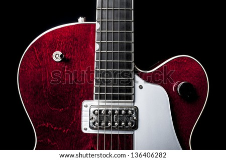 Shiny and sleek red electric guitar again a black back drop.  American made rock and roll.  Perfect for any musical theme.