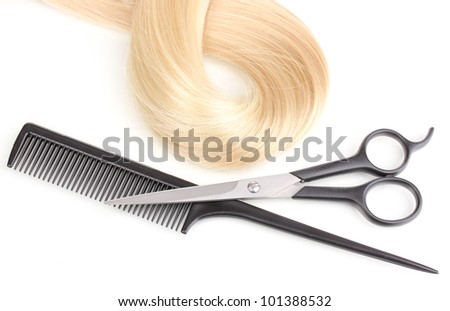 Shiny blond hair with hair cutting shears and comb isolated on white - stock photo