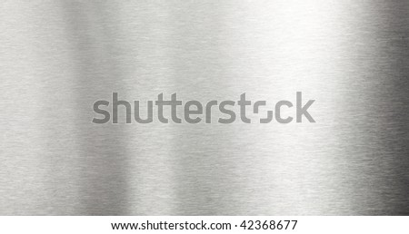 Shiny brushed metal plate surface - stock photo