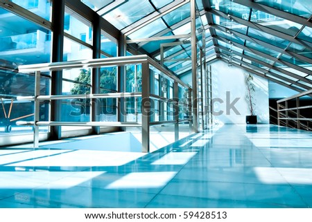 shiny ceiling inside clean hallway - stock photo